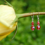 Two Crystal Earrings shown in Sterling Silver Padparadscha.