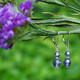 Two Crystal Earrings shown in Sterling Silver Tanzanite.