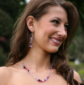 Cupid Necklace in Sterling Silver. Shown with Cupid Cluster Earrings.
