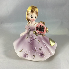The February Birthstone Doll is in excellent condition...