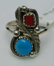Navajo Sterling Silver Feather Turquoise & Red Mediterrian Coral Traditional Ring.  Your Price $27.99   List Price $79.99  Each Ring Will Be Shipped in it's Own Ring Box  Stones: Nevada Turquoise from Blue Gem Mine Near Lander Nevada  Mediterranean Red Coral from Italy  Meaning Of this Ring in Navajo Culture: Turquoise Peace, Success, and Wisdom.    Red Coral: Cleansing of Body & Spirit  Feather: For Protection & Good Luck  Hand Made Rings so Please Allow For Differences  All These Rings are One Of A Kind the Settings are  Done to Size of the Turquoise Stones & Coral.