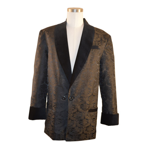 "Men's black brocade smoking jacket with bemberg lining.  Black velvet cuff and collar.  Adjustable 3"" sleeves to lengthen or shorten"