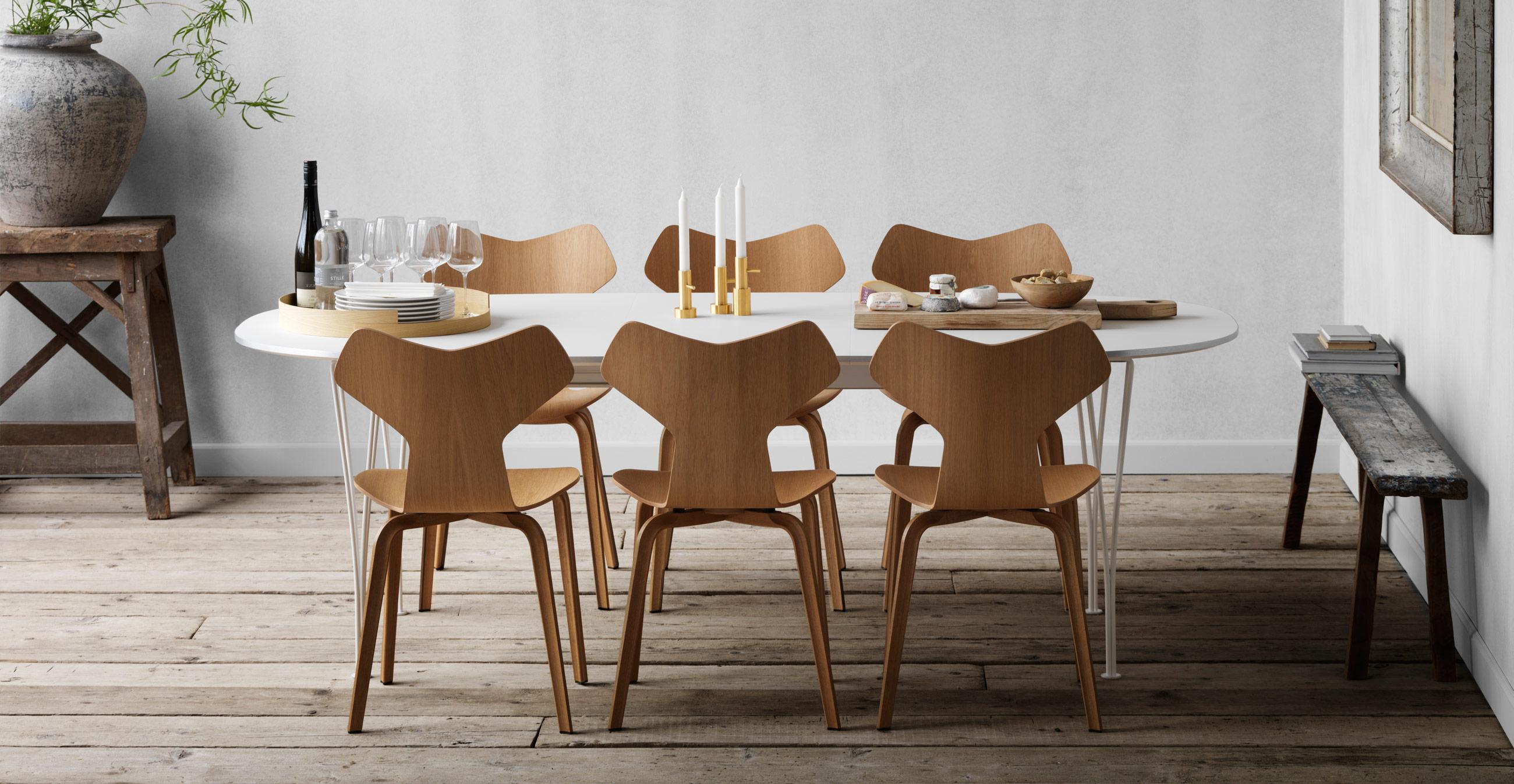 Fritz Hansen Super Elliptical Table White Laminate & White Base with Grand Prix Chairs