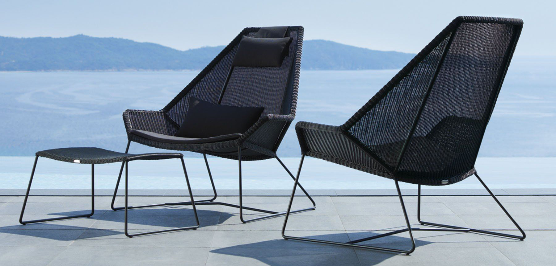 cane-line breeze high back outdoor lounge chair lifestyle image