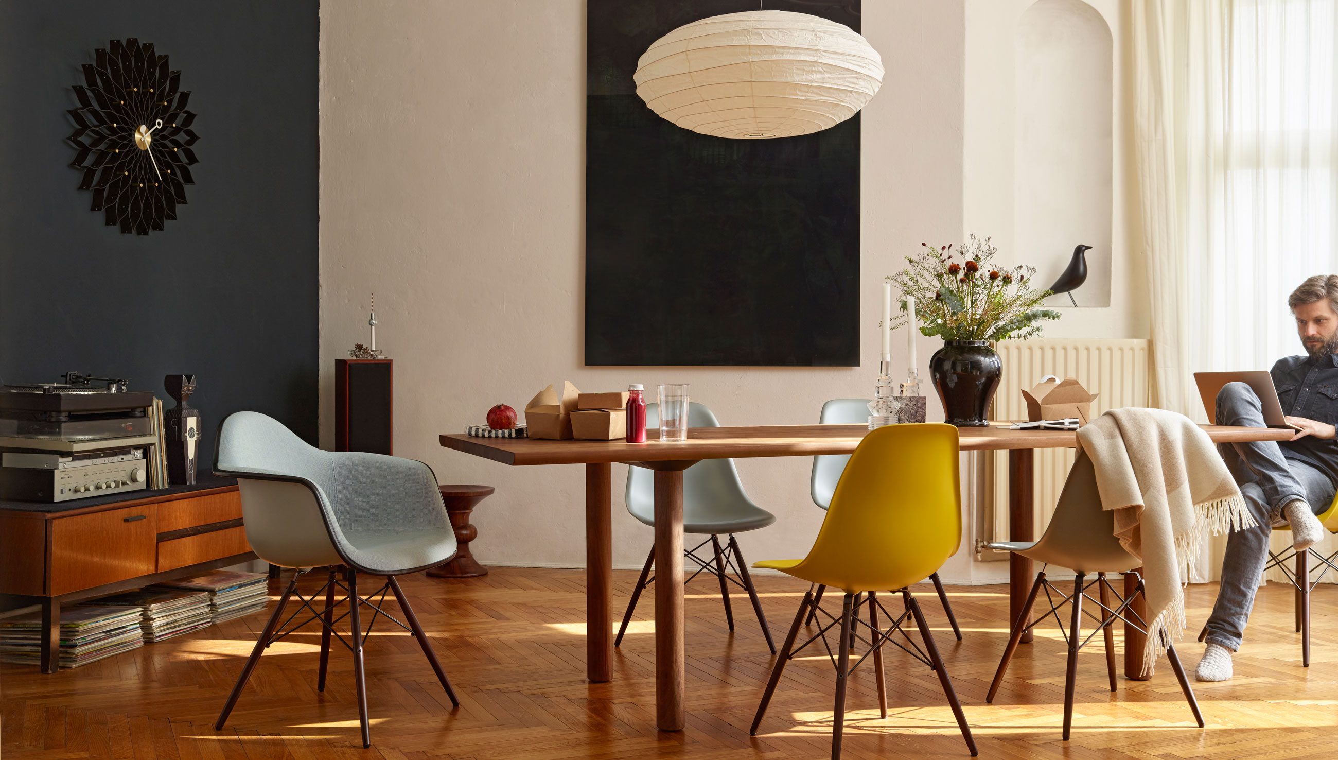 Vitra Wood Table with Eames Plastic Side Chair DSW Eames Plastic Armchair DAW and Sunflower Wall Clock Black Ash