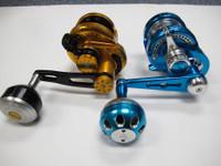 Jigging Master PE2 Reel (Blue/Silver) vs. Wiki 900H Reel (Gold/Black)