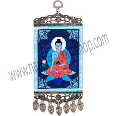 """Our inspiring mini-carpet wall charm has been designed with the serene image of the Medicine Buddha, the powerful healer of spirit. Both ends of the carpet have been finished with an intricate antiqued metal frame. The bottom frame also features matching antique metal teardrop tassels. SYMBOL Medecine Buddha - See more at: http://www.kheopsinternational.com/p/Wall-Hanging-Carpet-Medecine-Buddha/63378.html#sthash.Q0PbzrA9.dpuf"
