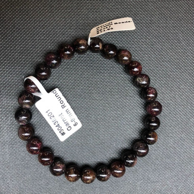 1 Garnet Stretch Bead Bracelet 5-7mm  NOTE: Stock image you will receive a similar bracelet.