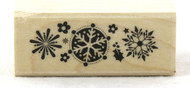 Click here to buy Snowflake Trio Wood Mounted Rubber Stamp Hero Arts