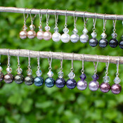 Top row (left to right): Bronze, Champagne, White, Light Gray, Dark Gray, Black Bottom Row (left to right): Brown, Dark Green, Peacock, Dark Purple, Mauve, Burgundy