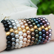 Pearl Stretch Bracelets shown in (left to right) Mystic Black, Dark Gray, White, Powder Almond, Bronze, Brown, Dark Green, Tahitian Look, Dark Purple, Burgundy, Mauve.