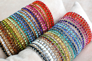 Silver & Gold Swarovski Crystal Stretch Bracelets in (left to right) Light Siam, Hyacinth, Padparadscha, Fuchsia, Rose, Purple Velvet, Tanzanite, Aquamarine, Montana, Sapphire, Zircon, Peridot, Light Topaz, Olivine, Dorado*, Light Colorado Topaz, Smoky Topaz, Crystal (Clear), White Opal**, Black Diamond**, Jet (Black) *Not available in Silver. **Not available in Gold.