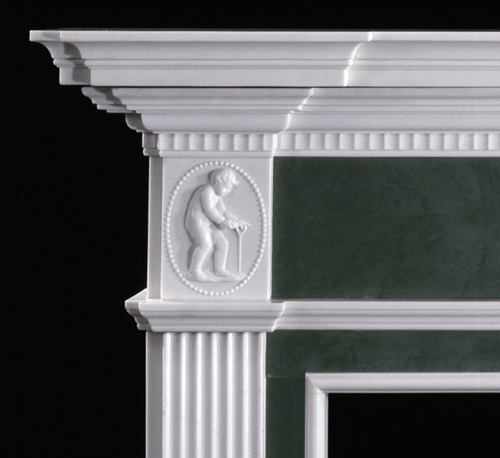 Our Great Britain Marble Mantel has delicate cherubs.  Customize it with different color inserts, or request we remove the cherubs, if you like.