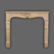 The Provence marble mantel has a simple yet beautiful shell as a center piece and  detailed, slightly angled legs