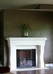 A Stone Fireplace Mantel with traditional styling