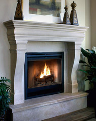 """This traditional mantel is shown on a custom 12"""" raised hearth"""
