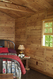 Western Red Cedar paneling in this rustic cabin bedroom - real plywood paneling