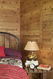 Detail of horizontal and vertical plank laminate pattern on each 4 x 8 sheet of rustic paneling
