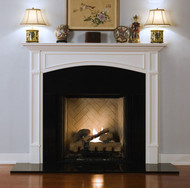 Recessed framed legs and decorative molding makes this an exquisite fireplace mantel, with a decorative arch.