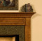 Dentil and picture frame molding are featured on this fireplace mantel