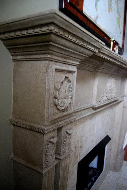 Cast Plaster mantel with faux finish. Featuring shells and acanthus leaves