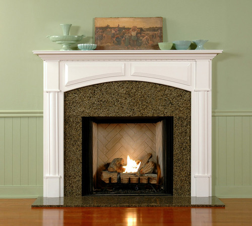 The elegant Lennox custom fireplace mantel has an arched breast.
