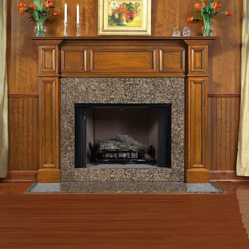 A furniture quality traditional wood fireplace mantel surround featuring a recessed panel design