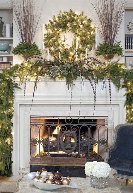 A mantel similar to our Albertville decorated in a grand fashion for Christmas