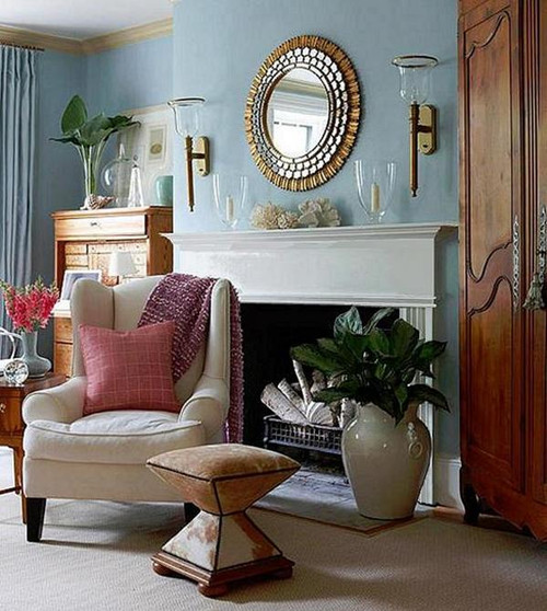 A Killen style mantel painted white used in a contemporary living room