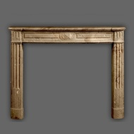 The clean lines are common with the Louis XVI style marble mantel