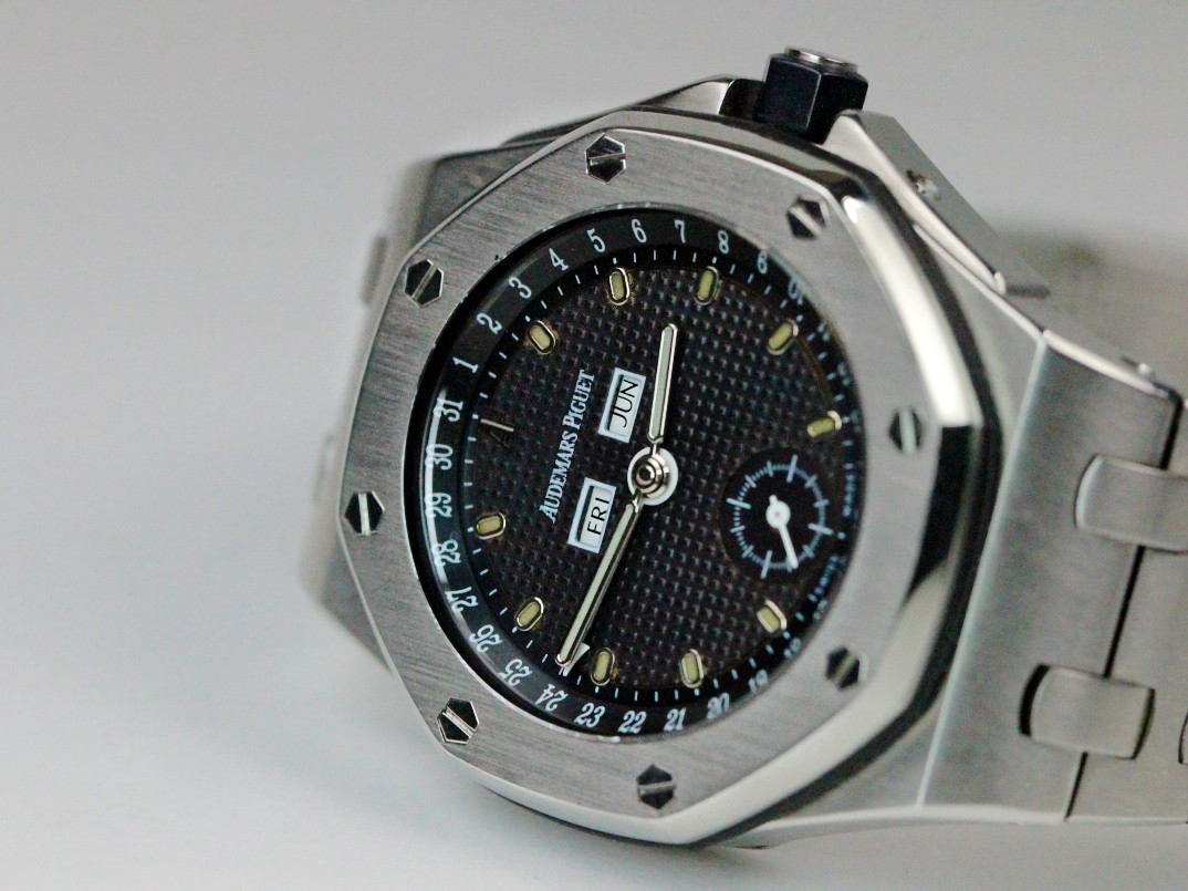 For sale used stainless steel rare Audemars Piguet Watch Royal Oak Offshore Triple Calendar Ref# 25807ST.00.1010ST.01, Black Dial.  Comes with Box and Pusher.  Available in store Chicago Watch Center and online www.Legendoftime.com