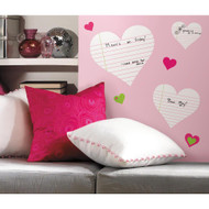 Keep important notes, dates, or even doodles right on your wall with these heart-shaped dry erase wall decals.