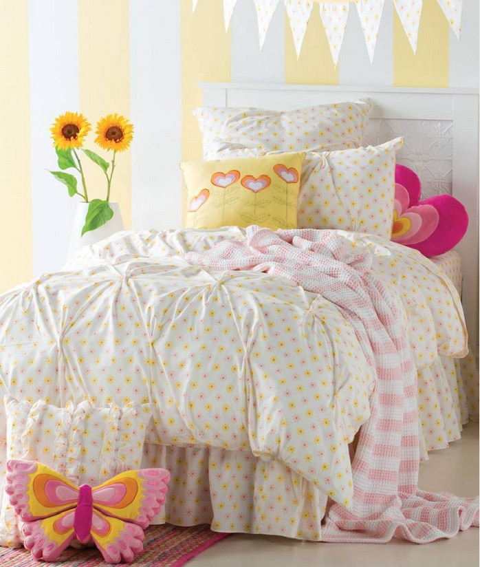 Flouncy, feminine and as fresh as a daisy. This simple printed daisy design is pintucked for textural interest. Finished with a dainty crochet edge in yellow. Bring sunshine and cheer into the bedroom.