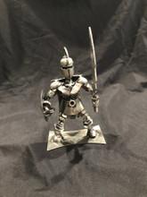 "Handcrafted Found Art  Spartan Warrior Up  Size: 6""H x 7""D x 3.5""W  Weight: 1.0 lb"
