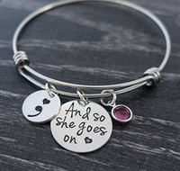 """And so she goes on"" Semi Colon Bangle Bracelet"