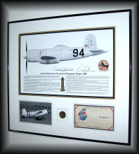 Also framed into this piece is a commemorative Cleveland Air race coin, and Air Mail First Day Cover.