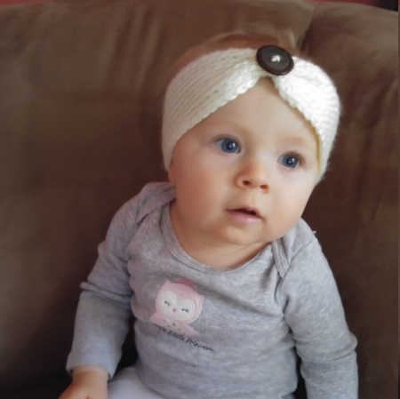 baby with knitted headband head