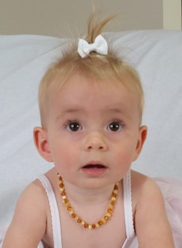 baby ruby with amber teething necklace