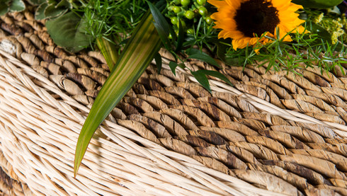 Detail of banana leaf strands woven into a coffin