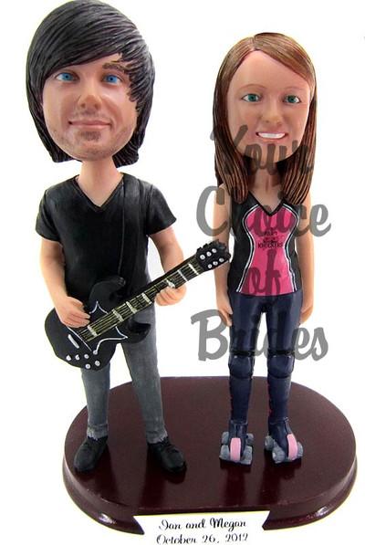 Guitarist groom and bride cake topper