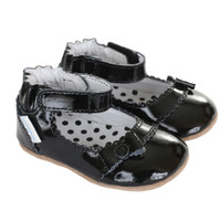 Girls' baby shoes in black patent leather.  Soft Soled with rubber out sole.