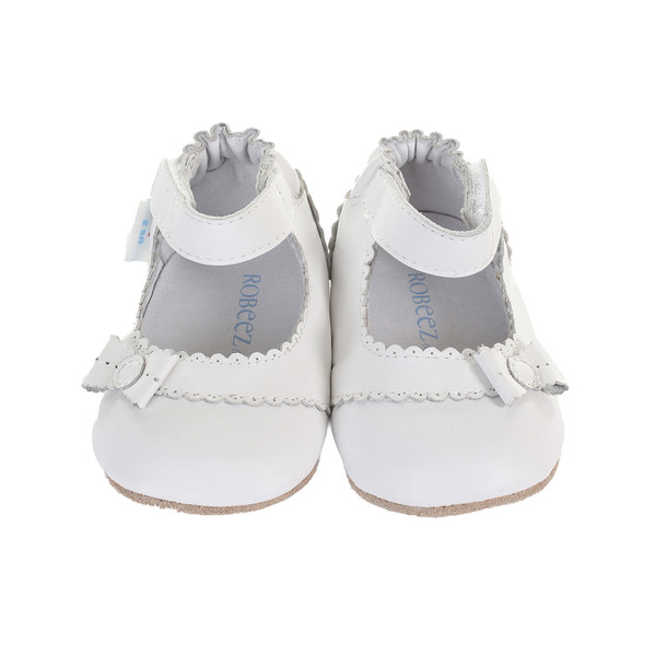 Girls' baby shoes in white leather. Soft soled with rubber out sole.  For pre walkers and beginner walkers.