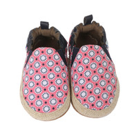 Pink canvas soft soled baby shoes with geometric floral pattern.  Perfect for learning to walk