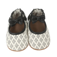 White leather soft soled baby shoes with black diamond pattern.  Sizes 0 - 24 months