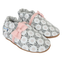 Soft soled baby shoes for girls with graphic floral pattern.