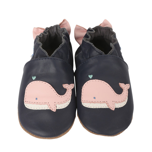 Soft soled infant shoes in blue leather featuring pink whales and bow