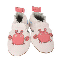 White leather baby shoes with soft soles for ages 0 - 24 months