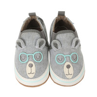 Grey canvas soft soled infant shoes that are designed to resemble a bear with glasses.