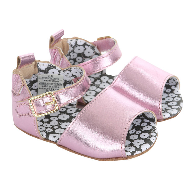 Pink metallic leather baby sandal for girls.  These soft soles shoes have an adjustable strap to secure the shoe.