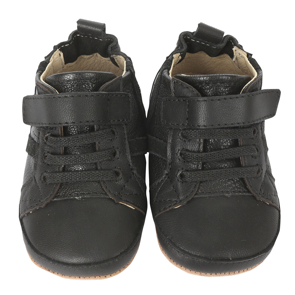 Black leather boy baby shoes with soft soles.